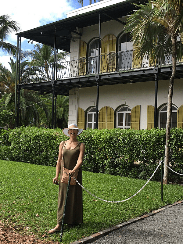 Janet Church  in  front of Hemingway house Key West